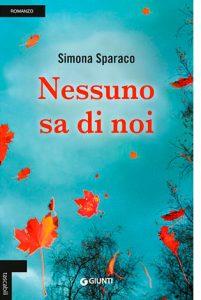 """La copertina di """"Nessuno sa di noi"""" di Simona Sparaco (Giunti)"""