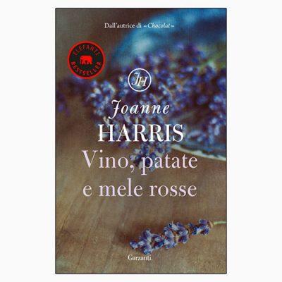 """La copertina del libro """"Vino, patate e mele rosse"""" di Joanne Harris (Garzanti)"""